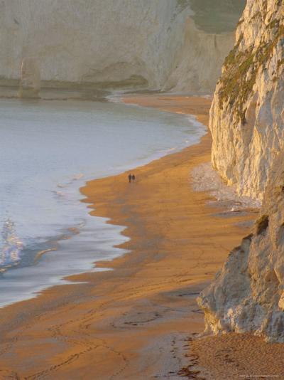 Couple Walking on Beach. Isle of Purbeck, Dorset, England UK-Jean Brooks-Photographic Print