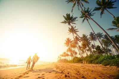 Couple Walking on the Sandy Beach with Palm Trees-Dudarev Mikhail-Photographic Print