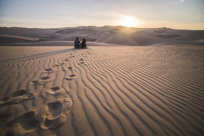Couple Watching the Sunset over Sand Dunes in the Desert at Huacachina, Ica Region, Peru-Matthew Williams-Ellis-Photographic Print