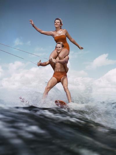 Couple Waterskiing Together-Dennis Hallinan-Photographic Print