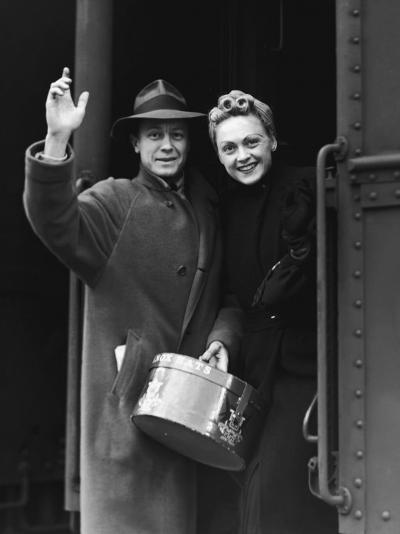 Couple Waving As They Board a Train, Circa 1930's--Photographic Print