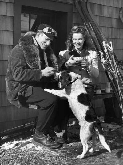 Couple With Dog in Front of Ski Lodge-George Marks-Photographic Print