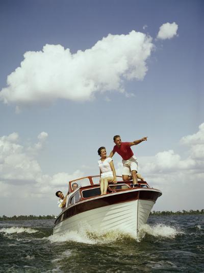 Couples Enjoy Speed Boat Ride-Dennis Hallinan-Photographic Print