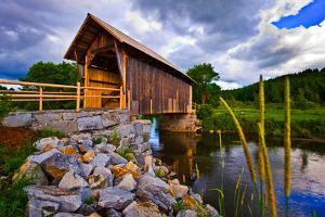 Covered bridge on river, Vermont, USA
