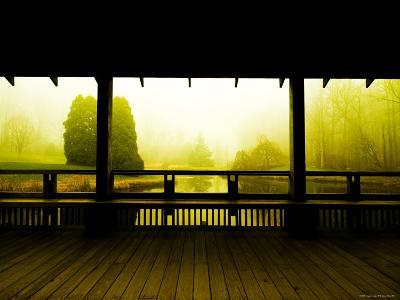 Covered Deck Looking onto Peaceful River and Fog-Jan Lakey-Photographic Print