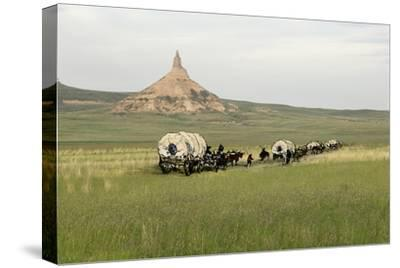 Covered Wagons Passing Chimney Rock, a Landmark on the Oregon Trail, Nebraska