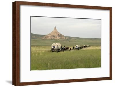 Covered Wagons Passing Chimney Rock, a Landmark on the Oregon Trail, Nebraska