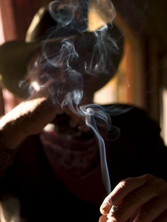 https://imgc.artprintimages.com/img/print/cowboy-actor-smoking-on-an-old-western-movie-set_u-l-p8em9m0.jpg?p=0