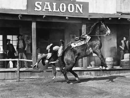 Cowboy Being Thrown Off His Horse--Photo