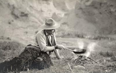 Cowboy Cooking over Campfire