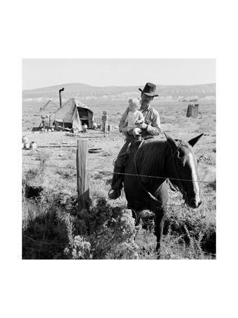 https://imgc.artprintimages.com/img/print/cowboy-holds-his-baby-while-riding-a-horse_u-l-pgjr2d0.jpg?p=0