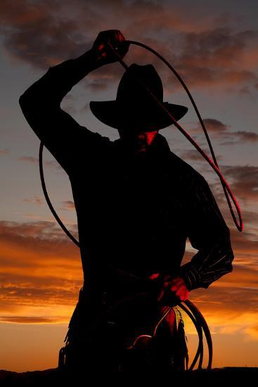 Cowboy in Sunset with Rope-Alan and Vicena Poulson-Photographic Print