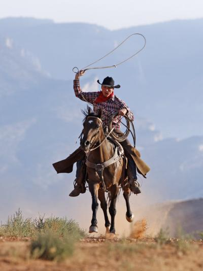 Cowboy Running with Rope Lassoo in Hand, Flitner Ranch, Shell, Wyoming, USA-Carol Walker-Photographic Print