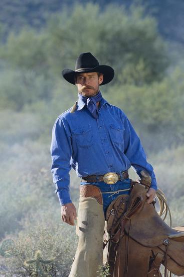 Cowboy with His Saddle-DLILLC-Photographic Print