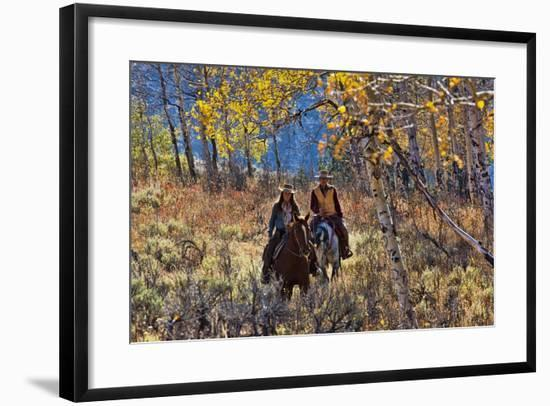 Cowgirl and Cowboy Riding Together-Terry Eggers-Framed Photographic Print