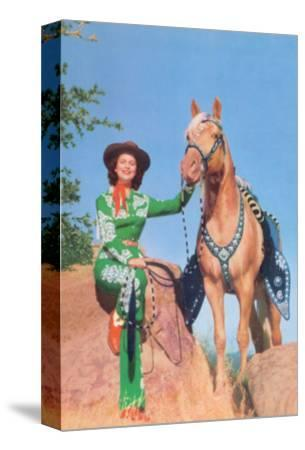 Cowgirl in Green Outfit with Palomino
