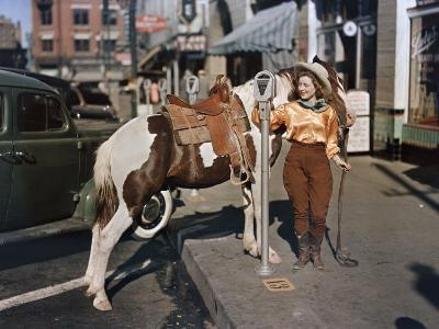 Cowgirl Puts a Nickel in an El Paso Parking Meter to Hitch Her Pony-Luis Marden-Photographic Print