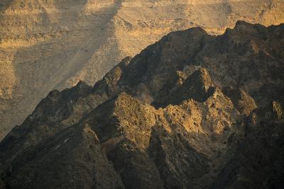 Craggy Coastline Off Oman-Michael Melford-Photographic Print