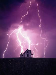 Lightning Behind a Farmhouse by Craig Aurness