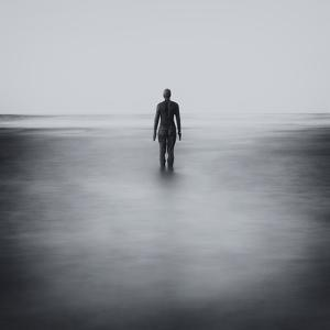 Statue Alone on Beach by Craig Roberts