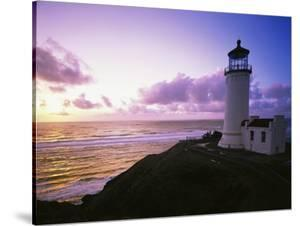 Lighthouse by Beach at Sunset by Craig Tuttle