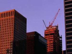 Crane Atop Skyscraper under Construction in City