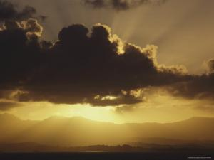 Crepuscular Rays Beam out from Behind a Cloud at Twilight