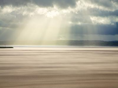 Crepuscular Rays Through Stormy Sky While Shifting Sands Create a Cloud Underfoot, Wirral, England-Craig Easton-Photographic Print