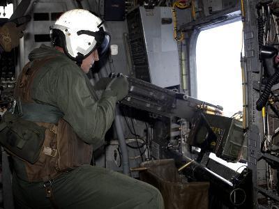Crew Chief Fires An M2 .50-caliber Heavy Machine Gun from a CH-53E Super Stallion-Stocktrek Images-Photographic Print