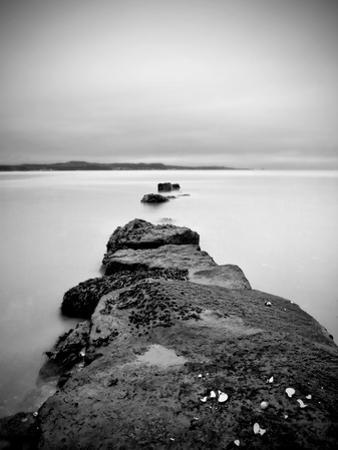 Rocks on a Shore Leading into the Sea