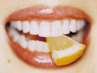 Slice of Lemon Between Teeth