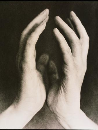View of a Woman's Hands Held Together