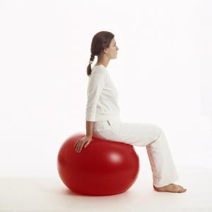 Woman Sitting on Exercise Ball by Cristina