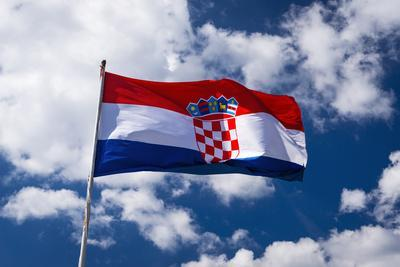 https://imgc.artprintimages.com/img/print/croatian-flag-against-blue-sky-and-clouds-ston-croatia_u-l-q1d5vfz0.jpg?p=0