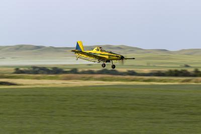 Crop Duster Airplane Spraying Farm Field Near Mott, North Dakota, USA-Chuck Haney-Photographic Print