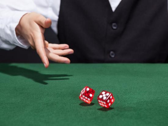 Croupier Throwing A Pair of Dice-AndreyPopov-Photographic Print