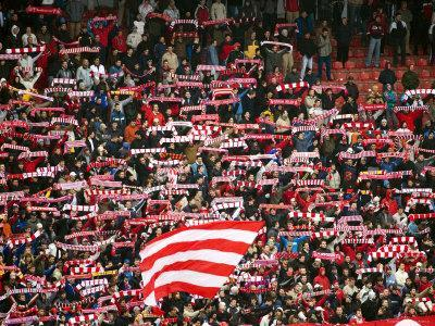 https://imgc.artprintimages.com/img/print/crowd-of-fans-raise-scarves-in-support-of-red-star-one-of-sebia-s-premier-soccer-teams_u-l-p5xlf30.jpg?p=0