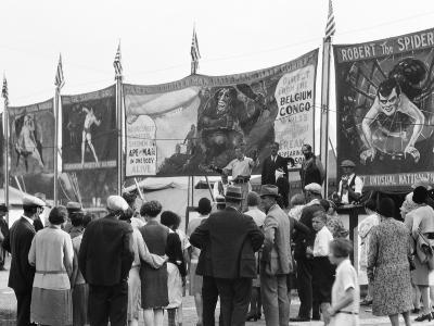 Crowd Watching Sideshow Performers in Front of Circus Posters, Outdoors-H^ Armstrong Roberts-Photographic Print