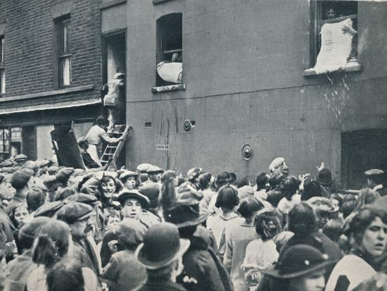 Crowd watching the looting of a German house in Poplar, c1914-Unknown-Photographic Print