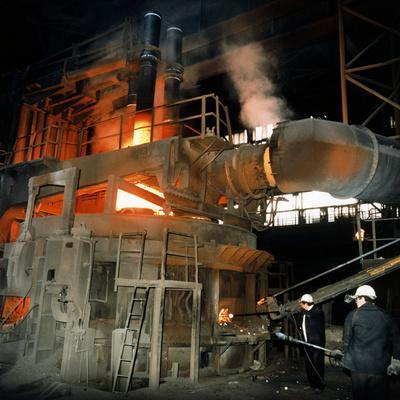 Workers Attending To a Blast Furnace.