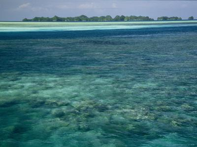 Crystal Clear Blue Waters over a Polynesian Reef-Tim Laman-Photographic Print