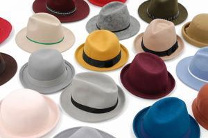 Top View Many Woman Hat on White Background by crystalfoto