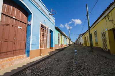 Cuba. Casa Particulares Line the Street, Shown by their Particular Logo Above the Street Number-Inger Hogstrom-Photographic Print