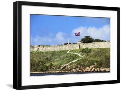 Cuba, Havana. Fortress wall and Cuban flag at San Carlos de la Cabana fortress in the Parque Histor-Miva Stock-Framed Photographic Print
