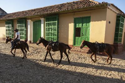 Cuba, Trinidad. Pulling Horses Along Cobblestone Street-Brenda Tharp-Photographic Print