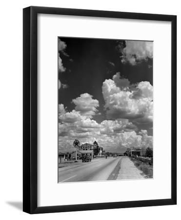 Cumulus Clouds Billowing over Texaco Gas Station along a Stretch of Highway US 66-Andreas Feininger-Framed Premium Photographic Print