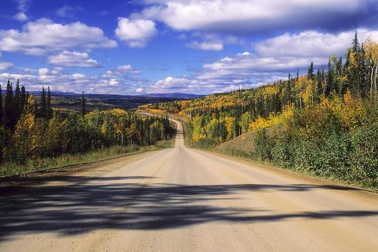 Cumulus Clouds Drift over a Colorful Autumn Landscape-Jim Reed-Photographic Print