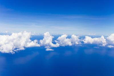 Cumulus Clouds Floating Above Flat Calm Seas on the Atlantic Ocean, Somewhere Near the Bahamas-Mike Theiss-Photographic Print