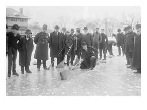 Curling in Central Park with Men Having Brooms at the Ready over the Ice.