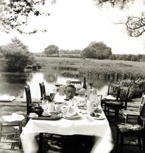 Outdoor Table Setting with Man's Head by Curtis Moffat